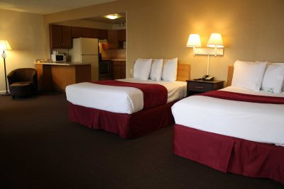 twin bed room in California Suites Hotel